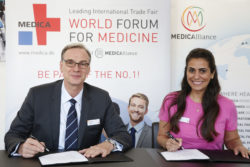 "Photo: ""Wolfram Diener (Managing Director Messe Düsseldorf) and Malu Sevieri (EMME BRASIL/ Representative of Messe Düsseldorf in Brazil) sign the organiser contract""."