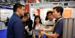 People in the midst of discussion at product stands