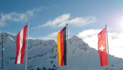 Photo: Flags of Austria, Germany and Switzerland in front of the Alps
